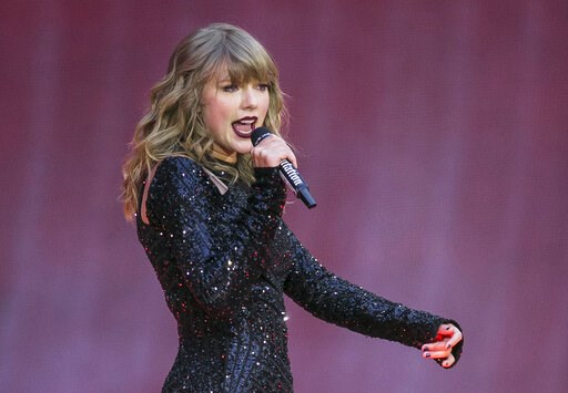 """(Photo by Joel C Ryan/Invision/AP, File). FILE - In this June 22, 2018, file photo, singer Taylor Swift performs on stage in concert at Wembley Stadium in London.  Swift says she turns off comments on social media to """"block some of the noise.""""  That's ..."""