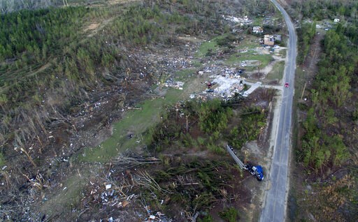 (AP Photo/David Goldman). A truck, lower right, lies on its side in a neighborhood devastated by a tornado that saw multiple members of a family killed in Beauregard, Ala., Tuesday, March 5, 2019.
