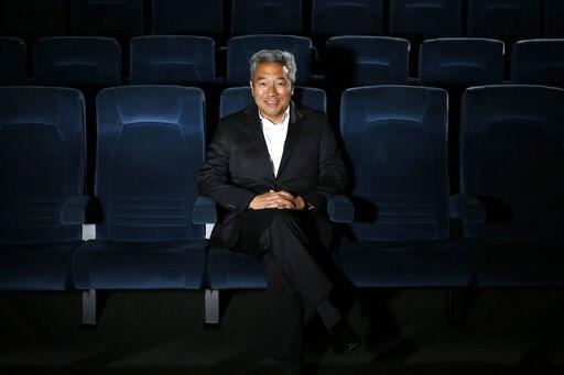(AP Photo/Jae C. Hong, File). FILE - In this Feb. 6, 2013, file photo, Kevin Tsujihara, poses for photos in a screening room at the Warner Bros. Studios in Burbank, Calif. WarnerMedia is investigating claims that Warner Bros. chairman and CEO Tsujihara...