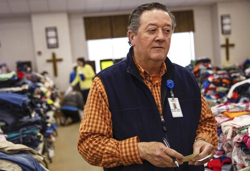 (AP Photo/David Goldman). In this Wednesday, March 6, 2019 photo, Rusty Sowell, pastor at Providence Baptist Church, speaks to volunteers organizing donations at the church in Beauregard, Ala. Dealing with the dead became a huge task in a rural Alabama...