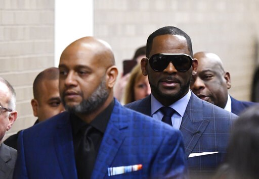(AP Photo/Matt Marton). Musician R. Kelly arrives at the Daley Center for a hearing in his child support case at the Daley Center, Wednesday, March 6, 2019, in Chicago. Kelly was charged last month with sexually abusing four females dating back to 1998...