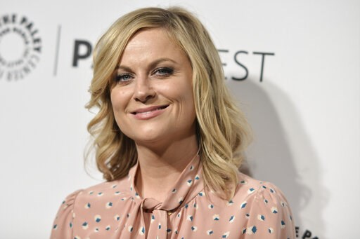 """(Photo by Richard Shotwell/Invision/AP, File). FILE - This March 18, 2014 file photo shows actress Amy Poehler at Paleyfest 2014 - """"Parks and Recreation,"""" in Los Angeles. The Paley Center for Media said Thursday, March 7, 2019, it is launching on-deman..."""