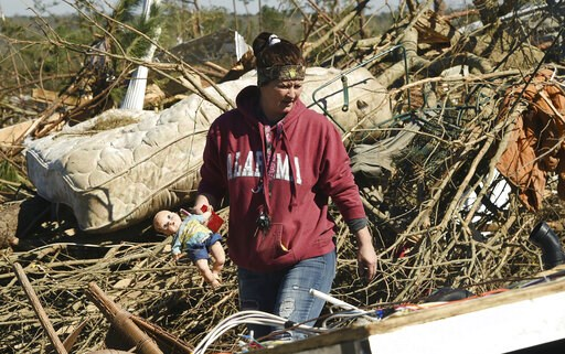 (Joe Songer/AL.com. via AP). Residents searching for belongings are dwarfed by the devastation in Beauregard, Ala., Wednesday, March 6, 2019. The twister that smashed Beauregard was the deadliest U.S. tornado in nearly six years. The weather service sa...
