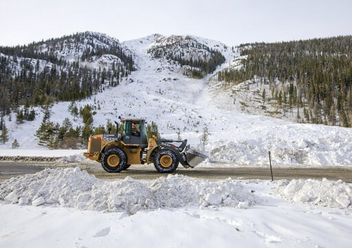 (Hugh Carey/Summit Daily News via AP, File). FILE - In this March 5, 2019 file photo, crews work to remove the snow debris from a controlled avalanche that spilled onto Interstate 70 near Loveland Pass, Colo. Historic avalanche conditions persisted in ...