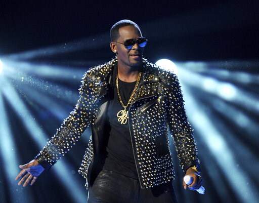 (Photo by Frank Micelotta/Invision/AP, File). FILE - In this June 30, 2013 file photo, R. Kelly performs at the BET Awards in Los Angeles. In his first interview since being charged with sexually abusing four people, including three underage girls, R. ...