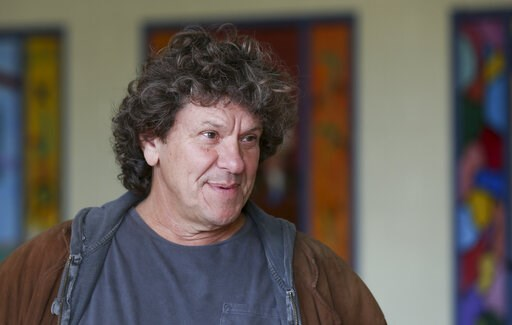 (AP Photo/Mike Groll, File). FILE  - In this Wednesday, Oct. 14, 2015, file photo, Michael Lang speaks during a tour at the former Zena Elementary School in Woodstock, N.Y. Woodstock co-founder Michael Lang says the wait is almost over regarding perfor...