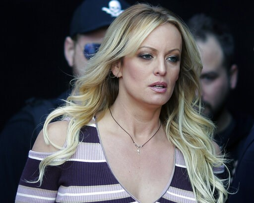 """(AP Photo/Markus Schreiber, File). FILE - In this Oct. 11, 2018, file photo, adult film actress Stormy Daniels arrives at the adult entertainment fair """"Venus"""" in Berlin. A federal judge has thrown out a lawsuit against President Donald Trump by porn ac..."""