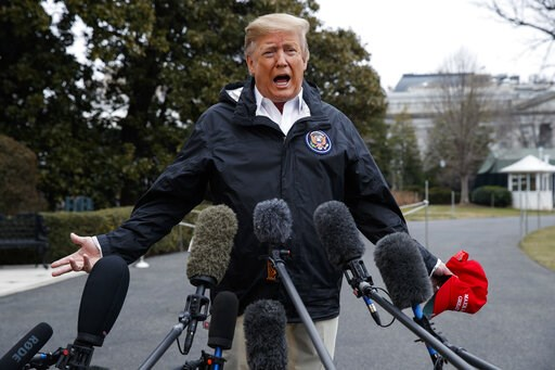 (AP Photo/ Evan Vucci). President Donald Trump talks with reporters outside the White House before traveling to Alabama to visit areas affected by the deadly tornados, Friday, March 8, 2019, in Washington.