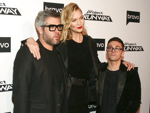 """(Photo by Andy Kropa/Invision/AP). Brandon Maxwell, from left, Karlie Kloss and Christian Siriano attend the season premiere of Bravo's """"Project Runway"""" at Vandal on Thursday, March 7, 2019, in New York."""