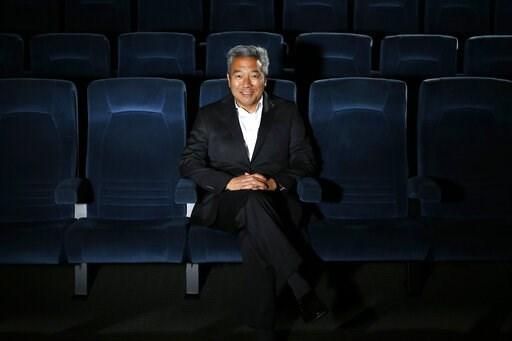 (AP Photo/Jae C. Hong, File). FILE - In this Feb. 6, 2013, file photo, Kevin Tsujihara, poses for photos in a screening room at the Warner Bros. Studios in Burbank, Calif.   Tsujihara is apologizing to his staff amid a WarnerMedia investigation into se...