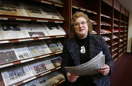 "(AP Photo/Gerry Broome). Penelope Muse Abernathy, a University of North Carolina professor, stands with the daily newspaper selection in the Park Library at the School of Journalism in Chapel Hill, N.C., on Thursday, March 7, 2019. ""Strong newspapers h..."
