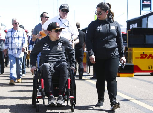 (Dirk Shadd/Tampa Bay Times via AP). Robert Wickens, left, leaves the pit area at the IndyCar Grand Prix of St. Petersburg auto race in St. Petersburg, Fla., Friday, March 8, 2019. Wickens returned to a race track for the first time since he suffered a...