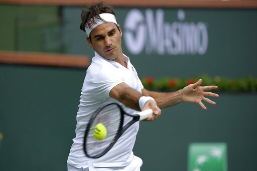 (AP Photo/Mark J. Terrill). Roger Federer, of Switzerland, returns a shot to Peter Gojowczyk, of Germany, at the BNP Paribas Open tennis tournament Sunday, March 10, 2019, in Indian Wells, Calif.