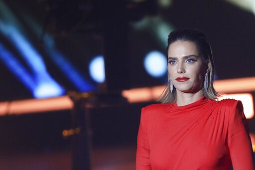 (AP Photo/Noam Revkin Fenton/Flash90). This Tuesday, Feb. 12, 2019 photo, shows Rotem Sela, one of Israel's top models and TV hosts, during a tv reality show filming near Jerusalem. Wonder Woman star Gal Gadot has come to the rescue of a fellow Israeli...