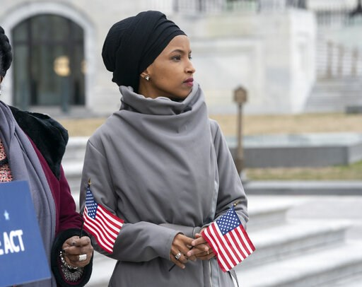 """(AP Photo/J. Scott Applewhite). Rep. Ilhan Omar, D-Minn., stands with fellow Democrats as they rally outside the Capitol ahead of passage of H.R. 1, """"The For the People Act,"""" a bill which aims to expand voting rights and strengthen ethics rules, in Was..."""