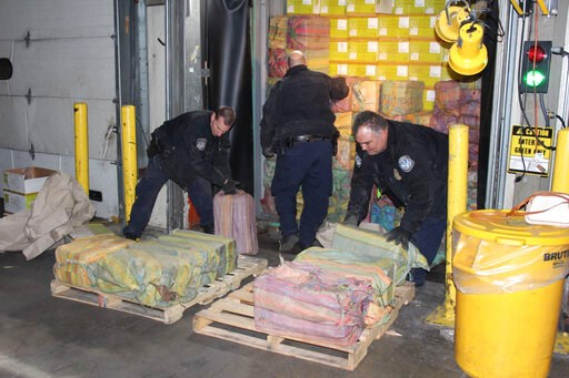 (U.S. Customs and Border Protection via AP). This Feb. 28, 2019 photo provided by U. S. Customs and Border Protection shows Customs agents unloading a truck containing 3,200 pounds of cocaine in 60 packages, where it was seized at the Port of New York/...
