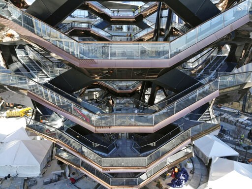 """(AP Photo/Ted Shaffrey). This March 5, 2019, photo taken with a drone shows """"Vessel,"""" a 150-foot-tall structure of climbable interlocking staircases, that is the center point of the $25 billion Hudson Yards Redevelopment in New York. The climbable stru..."""