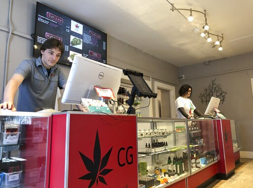 (AP Photo/Morgan Lee). In this Wednesday, March 6, 2019 photo, Korbin Osborn, left, works as a cannabis adviser at a medical marijuana dispensary in Santa Fe, N.M. New Mexico took a step toward legalizing recreational marijuana when its House approved ...