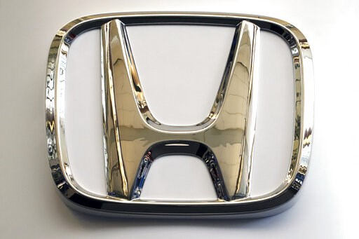 (AP Photo/Gene J. Puskar). In this Feb. 14, 2019, photo, this photo shows the Honda logo on a sign at the 2019 Pittsburgh International Auto Show in Pittsburgh. Honda will be recalling about 1 million older vehicles in the U.S. and Canada because the T...