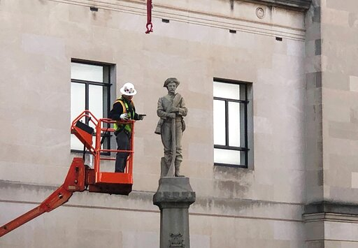 (AP Photo/Tom Foreman Jr.). A workman prepares a Confederate staute for removal, Tuesday, March 12, 2019, in Winston-Salem, N.C. Crews began removing the Confederate statue Sunday from the grounds of an old courthouse. North Carolina has been at the fo...