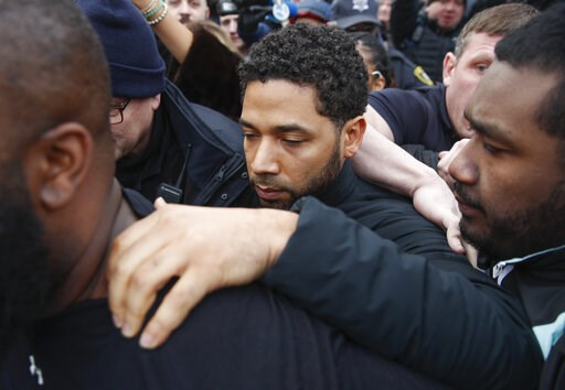 "(AP Photo/Kamil Krzaczynski, File). FILE - In this Feb. 21, 2019 file photo, ""Empire"" actor Jussie Smollett leaves Cook County jail following his release in Chicago. A Cook County grand jury on Friday, March 8, 2019 has indicted Smollett on 16 felony c..."