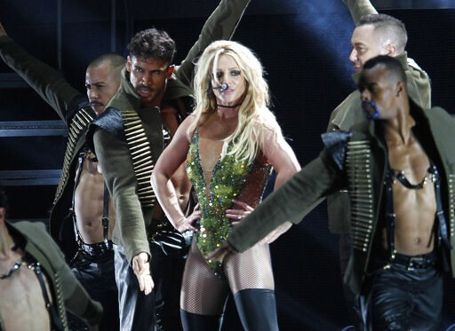 """(AP Photo/Chiang Ying-ying, File). FILE - In this June 13, 2017, file photo, U.S. singer Britney Spears performs during her concert in Taipei, Taiwan. Producers of the new musical stage comedy """"Once Upon a One More Time"""" say their show will use Spears'..."""