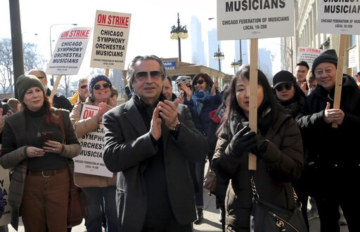 (Antonio Perez/Chicago Tribune via AP). Chicago Symphony Orchestra conductor Riccardo Muti joins in solidarity with striking CSO musicians during a press conference outside the Chicago Symphony Orchestra building, Tuesday, March 12, 2019.