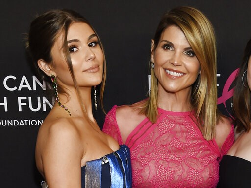 "(Photo by Chris Pizzello/Invision/AP, File). FILE - In this Feb. 28, 2019 file photo, actress Lori Loughlin poses with her daughter Olivia Jade Giannulli, left, at the 2019 ""An Unforgettable Evening"" in Beverly Hills, Calif. Felicity Huffman and Loughl..."