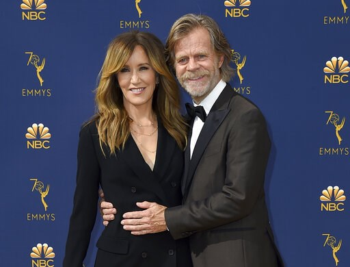 (Photo by Jordan Strauss/Invision/AP, File). FILE - In this Sept. 17, 2018 file photo, Felicity Huffman, left, and William H. Macy arrive at the 70th Primetime Emmy Awards in Los Angeles.  Huffman and Lori Loughlin were charged along with nearly 50 oth...