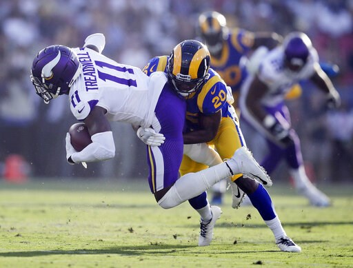 (AP Photo/Jae C. Hong, File). FILE - In this Sept. 27, 2018, file photo, Minnesota Vikings wide receiver Laquon Treadwell (11) is tackled by Los Angeles Rams defensive back Lamarcus Joyner during the first half in an NFL football game in Los Angeles.  ...