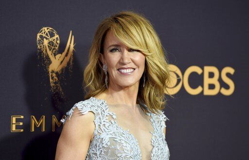 (Photo by Jordan Strauss/Invision/AP, File). FILE - This Sept. 17, 2017 file photo shows actress Felicity Huffman at the 69th Primetime Emmy Awards in Los Angeles. Huffman and Lori Loughlin have worked steadily as respected actresses and remained recog...