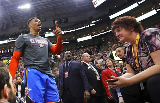 (AP Photo/Rick Bowmer). Oklahoma City Thunder's Russell Westbrook gets into a heated verbal altercation with fans in the first half of an NBA basketball game against the Utah Jazz, Monday, March 11, 2019, in Salt Lake City.