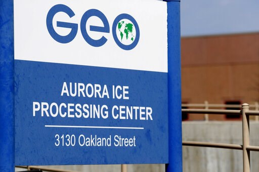 (AP Photo/David Zalubowski, File). FILE - This April 15, 2017, file photo, shows the entrance to the GEO Group's immigrant detention facility in Aurora, Colo. U.S. immigration authorities say more than 2,200 people exposed to a mumps outbreak in at lea...