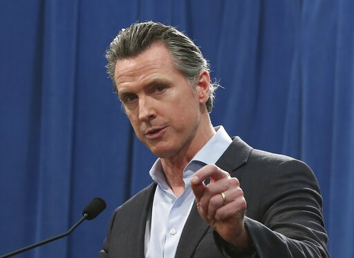 (AP Photo/Rich Pedroncelli, File). EMBARGO HOLD FOR RELEASE FOR PUBLICATION ON WEDNESDAY, MAR. 13, AND THEREAFTER - FILE - In this Monday Feb. 11, 2019 file photo Calif. Gov. Gavin Newsom answers questions at a Capitol news conference, in Sacramento, C...