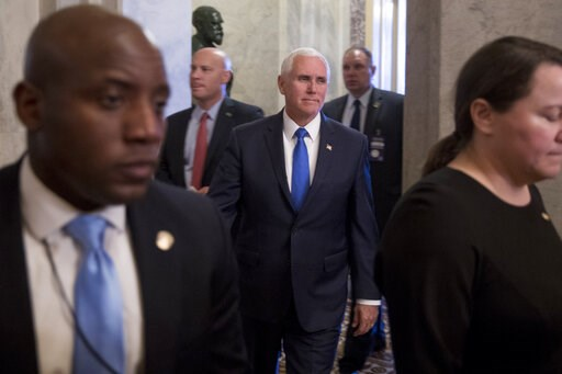 (AP Photo/Andrew Harnik). Vice President Mike Pence, center, accompanied by his Chief of Staff Marc Short, second from left, leaves the U.S. Capitol building on Capitol Hill in Washington, Tuesday, March 12, 2019.