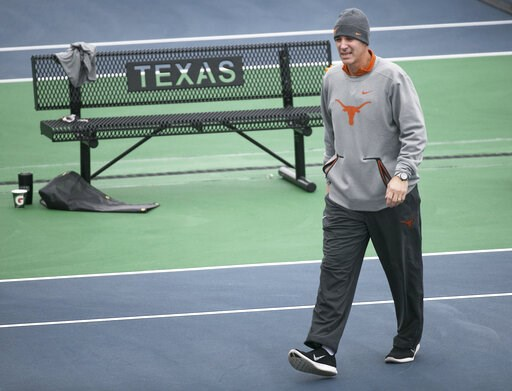 (Ralph Barrera/Austin American-Statesman via AP). In this January 2018 photo, Texas men's tennis coach Michael Center surveys the courts before the matches with UTSA, in Austin, Texas. Center is among a few people in the state charged in a scheme that ...