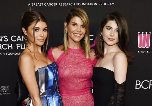 "(Photo by Chris Pizzello/Invision/AP, File). FILE - In this Feb. 28, 2019 file photo, actress Lori Loughlin, center, poses with daughters Olivia Jade Giannulli, left, and Isabella Rose Giannulli at the 2019 ""An Unforgettable Evening"" in Beverly Hills, ..."