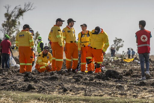 (AP Photo/Mulugeta Ayene). Investigators from Israel examine wreckage at the scene where the Ethiopian Airlines Boeing 737 Max 8 crashed shortly after takeoff on Sunday killing all 157 on board, near Bishoftu, or Debre Zeit, south of Addis Ababa, in Et...