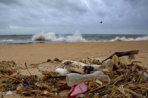 (AP Photo/Gemunu Amarasinghe, File). FILE - In this Aug. 13, 2015 file photo, a plastic bottle lies among other debris washed ashore on the Indian Ocean beach of Uswetakeiyawa, north of Colombo, Sri Lanka. According to a scientific report from the Unit...