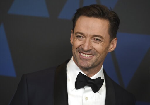 (Photo by Jordan Strauss/Invision/AP, File). FILE- In this March 13, 2019, file photo Hugh Jackman arrives at the Governors Awards at the Dolby Theatre in Los Angeles. Jackman is coming back to Broadway as a classic roguish traveling salesman. Producer...