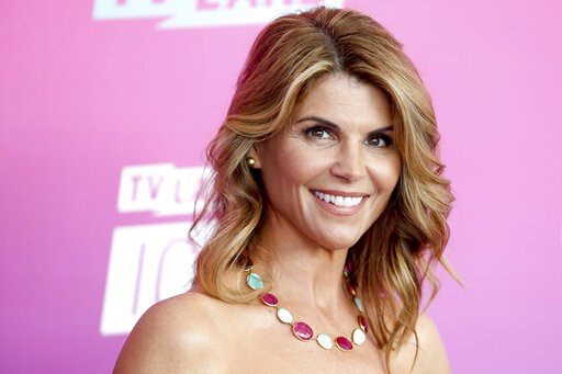 (Photo by Rich Fury/Invision/AP, File). FILE - In this April 10, 2016 file photo, actress Lori Loughlin arrives at the TV Land Icon Awards in Santa Monica, Calif. Felicity Huffman and Loughlin have worked steadily as respected actresses and remained re...