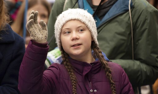 (Daniel Reinhardt/dpa via AP). Swedish climate activist Greta Thunberg gestures as she attends a protest rally in Hamburg, Germany, Friday, March 1, 2019.