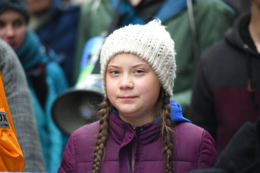 (Daniel Reinhardt/dpa via AP). Swedish climate activist Greta Thunberg attends a protest rally in Hamburg, Germany, Friday, March 1, 2019.