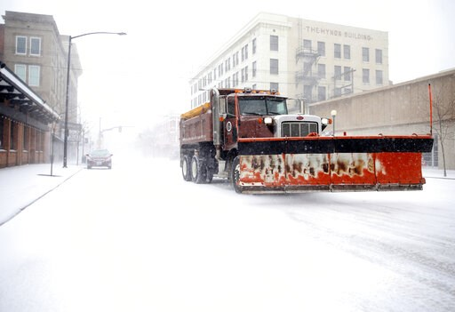 (Jacob Byk/The Wyoming Tribune Eagle via AP). A snow plow rumbles north on Capitol Avenue during a blizzard on Wednesday, March 13, 2019, in Cheyenne, Wyo. White-out conditions closed I-80, I-25, and U.S. 85, effectively closing off the state capital f...