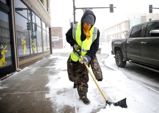 (Jacob Byk/The Wyoming Tribune Eagle via AP). Ryan Bredensteiner of Top Flight Maintenance shovels Central Avenue during a blizzard on Wednesday, March 13, 2019, in Cheyenne. White-out conditions closed I-80, I-25, and U.S. 85, effectively closing off ...