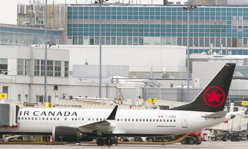 (Graham Hughes/The Canadian Press via AP). An Air Canada Boeing 737 Max 8 aircraft is parked next to a gate at Trudeau Airport in Montreal, Wednesday, March 13, 2019. Canada's transport minister says the country is closing air space to the Boeing 737 M...