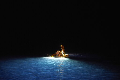 (AP Photo/David Keyton). The manned submersible surfaces after dark after a failed mission to recover a stranded ROV (Remotely Operated Vehicle), in the Indian Ocean near the Seychelles, Wednesday March 13, 2019. The previous day, an accident severed t...