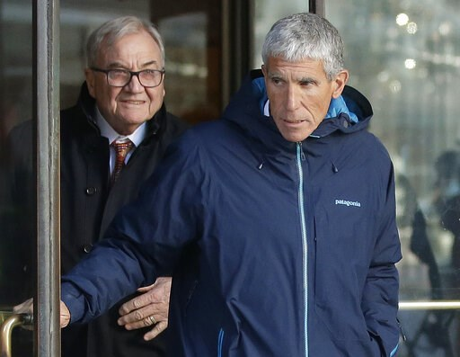 """(AP Photo/Steven Senne). William """"Rick"""" Singer, front, founder of the Edge College & Career Network, exits federal court in Boston on Tuesday, March 12, 2019, after he pleaded guilty to charges in a nationwide college admissions bribery scandal."""
