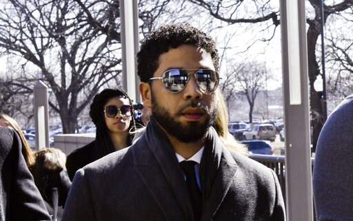 "(AP Photo/Matt Marton). ""Empire"" actor Jussie Smollett, center, arrives at Leighton Criminal Court Building for a hearing to discuss whether cameras will be allowed in the courtroom during his disorderly conduct case on Tuesday, March 12, 2019, in Chic..."