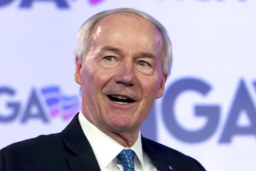 (AP Photo/Jose Luis Magana, File). FILE - In this Feb. 25, 2018 file photo, Arkansas Gov. Asa Hutchinson speaks at the National Governor Association 2018 winter meeting in Washington. Arkansas lawmakers have sent the governor legislation banning most a...